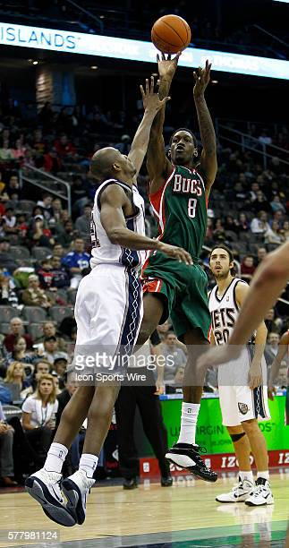 Milwaukee Bucks power forward Larry Sanders shoots over New Jersey Nets small forward Travis Outlaw at the Prudential Center in January 8 2011 in...