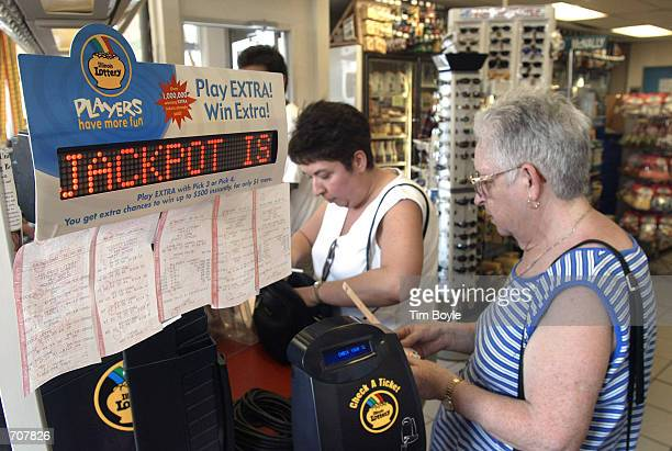 Milwaukee Wisconsin residents Guadalupe Fernandez and her daughter Angie are seen in line as they prepare to buy their Big Game lottery tickets at a...