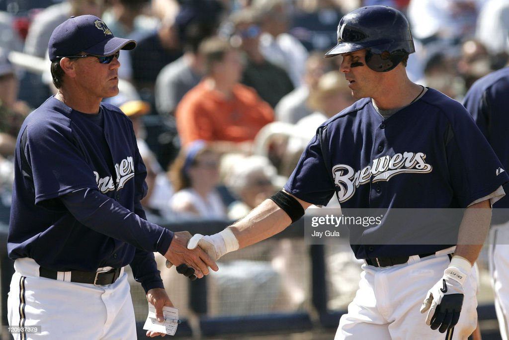 Milwaukee's Jeff Cirillo is congratulated by Manager Ned Yost after scoring vs SF in Cactus League action at Maryvale March 23 2006