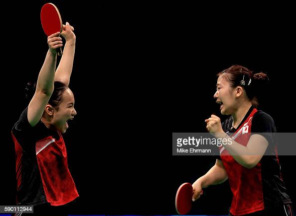 Mima Ito and Ai Fukuhara of Japan celebrate winning a doubles match against Yihan Zhou and Mengyu Yu of Singapore during the Womens Team Bronze Medal...