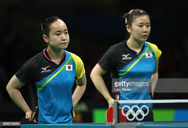 Mima Ito and Ai Fukuhara of Japan look on during the Women's Team Semifinal 2 against Xiaona Shan and Petrissa Solja of Germany on Day 9 of the Rio...