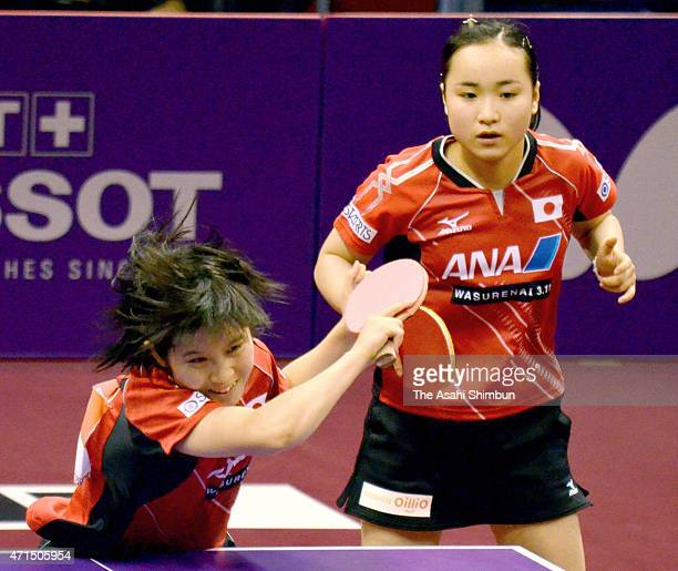 Mima Ito and Miu Hirano of Japan compete in the Women's Doubles Second Round match on day three of the 2015 World Table Tennis Championships on April...