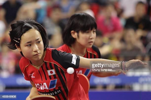 Mima Ito and Miu Hirano of Japan plays against Manyu Wang and Ke Chen of China during day five of 2014 ITTF World Tour Korea Open at on June 15 2014...