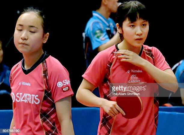 Mima Ito and Miu Hirano react after losing a point in the Women's Doubles second round during day two of the All Japan Table Tennis Championships at...
