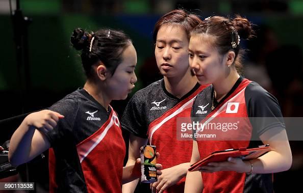 Mima Ito Kasumi Ishikawa and Ai Fukuhara of Japan talk during the Womens Team Bronze Medal match on Day 11 of the Rio 2016 Olympic Games at the...