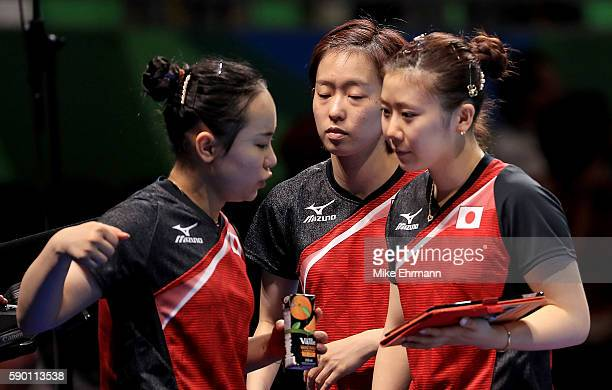 Mima Ito Kasumi Ishikawa and Ai Fukuhara of Japan talk during the Womens Team Bronze Medal match on Day 11 of the Rio 2016 Olympic Games at the...