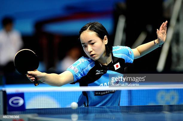 Mima Ito of Japan in action during U21 Women's single group 1st round of the 2014 ITTF World Tour Grand Finals at Huamark Indoor Stadium on December...
