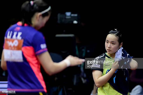 Mima Ito of Japan reacts against Li Xiaoxia of China during women's singles quarterfinal match on day six of the 2015 World Table Tennis...