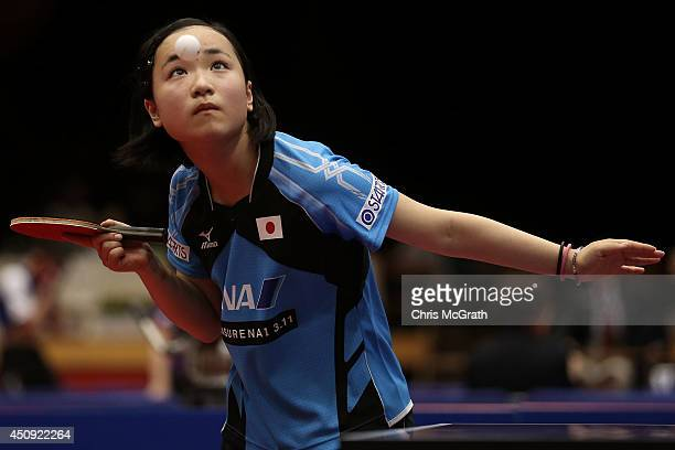 Mima Ito of Japan serves against He Zhuojia of China during their Women's Singles match on day one of 2014 ITTF World Tour Japan Open at Yokohama...