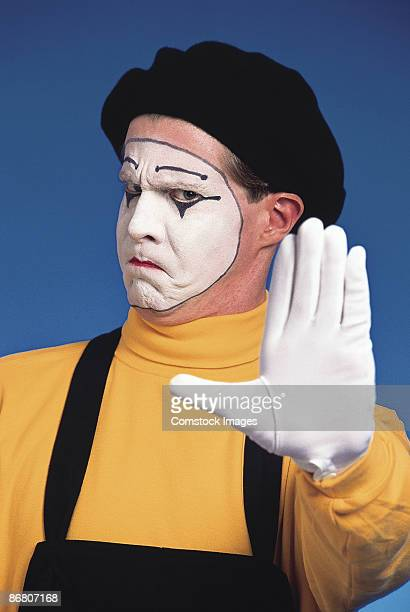 Mime holding out hand