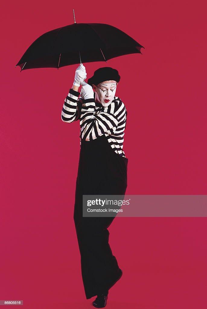 Mime with umbrella