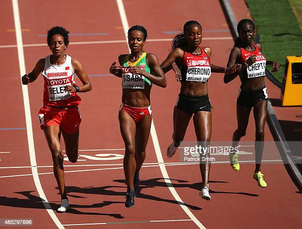 Mimi Belete of Bahrain Genzebe Dibaba of Ethiopia Mercy Cherono of Kenya and Irene Chepet Cheptai of Kenya cross the finish line in the Women's 5000...