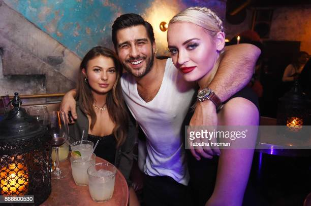Mimi Bouchard Alik Alfus and Daisy Robins attend Badoos #DateOfTheDead party with Daisy Lowe at La Bodega Negra on October 26 2017 in London England