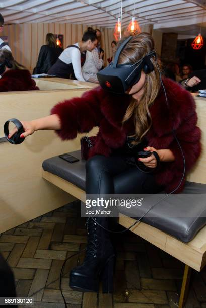 Mimi Bouchard interacts with the VR experience at the launch party of Air Canada Poutinerie popup to showcase #CoolNotCold destinations on November 1...