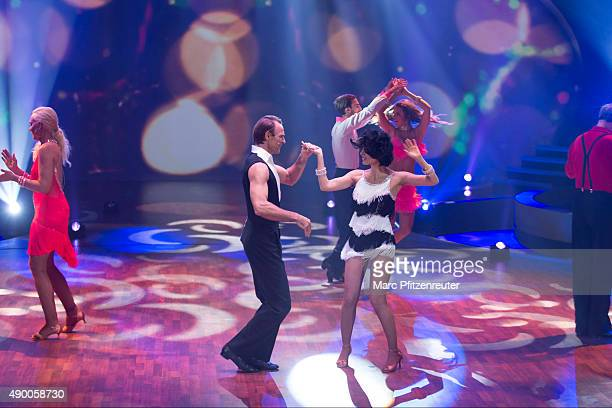 Mimi Fiedler and Bernhard Bettermann perform onstage during the third show of the television competition 'Stepping Out' at the Coloneum on September...