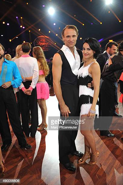 Mimi Fiedler and Bernhard Bettermann pose onstage during the third show of the television competition 'Stepping Out' at the Coloneum on September 25...