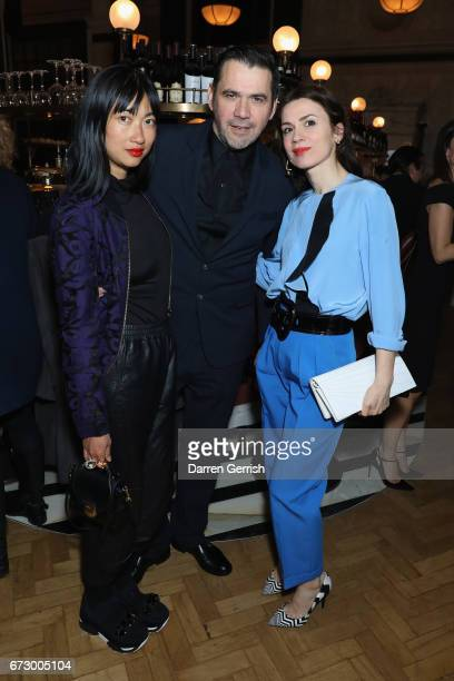Mimi Xu Roland Mouret and Lara Bohinc attend Roland Mouret's The Dinner of Love at Cecconi's a preopening dinner at The Ned on April 25 2017 in...