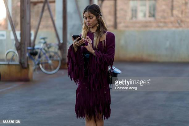 Mimie Lashiry wearing a purple dress at day 2 during MercedesBenz Fashion Week Resort 18 Collections at Carriageworks on May 15 2017 in Sydney...