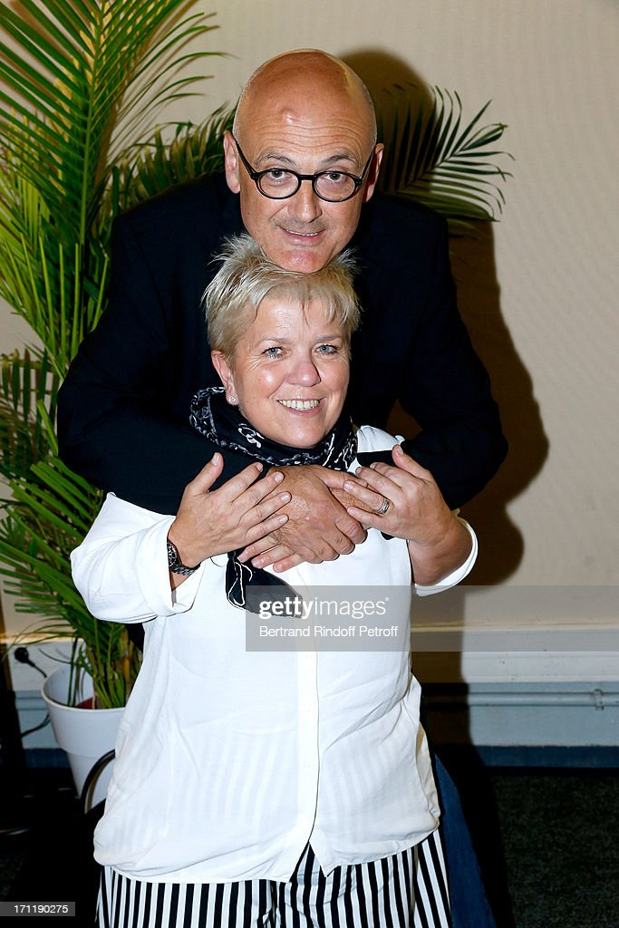 <a gi-track='captionPersonalityLinkClicked' href=/galleries/search?phrase=Mimie+Mathy&family=editorial&specificpeople=773620 ng-click='$event.stopPropagation()'>Mimie Mathy</a> (L) and her husband Benoist Gerard attend the last concert in Paris of Patrick Bruel, held at Palais Omnisports de Bercy on June 22, 2013 in Paris, France.