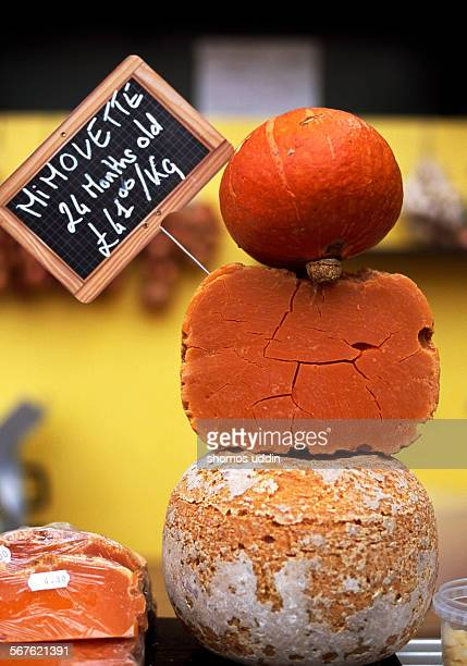 Mimolette and mini pumpkin at a market stall