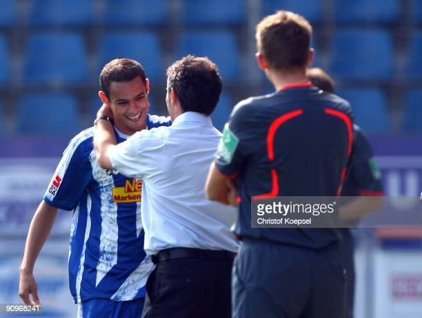 Mimoun Azaouagh of Bochum celebrates the first goal with head coach Marcel Koller of Bochum during the Bundesliga match between VfL Bochum and FSV...