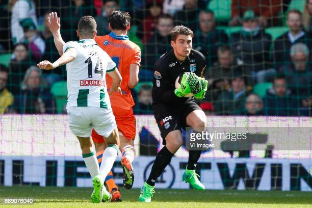 Mimoun Mahi of FC Groningen Dirk Marcellis of PEC Zwolle goalkeeper Mickey van der Hart of PEC Zwolleduring the Dutch Eredivisie match between FC...