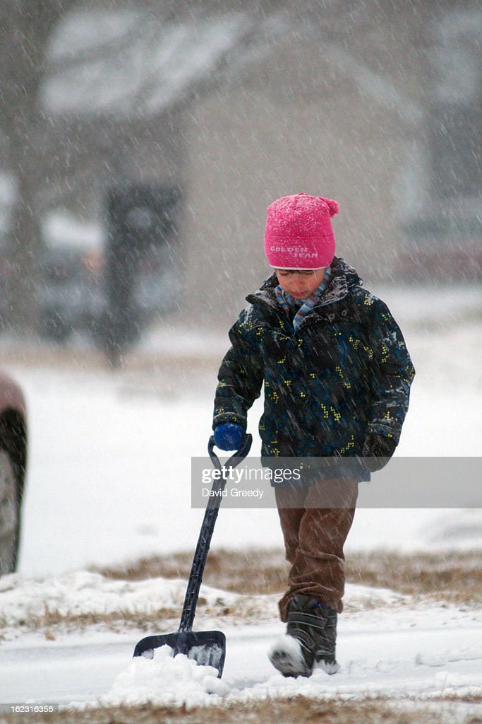 30 min after snow started to fall, 4 1/2 year old Lukas shovels the driveway at the start of a massive snowstorm on February 21, 2013 in Coralville, Iowa. The winter blizzard continues to move across the entire midwest, dumping up to a foot of snow in places as it moves east.