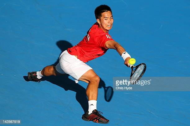 Min Hyeok Cho of Korea plays a backhand in his reversed singles match against Marinko Matosevic of Australia on day three of the Davis Cup Asia...