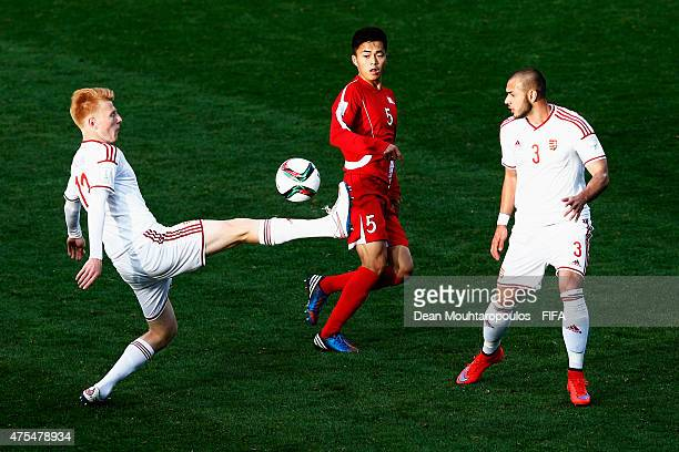 Min Hyo Song of Korea DPR and Zsolt Kalmar and Krisztian Tamas of Hungary battle for the ball during the FIFA U20 World Cup New Zealand 2015 Group E...