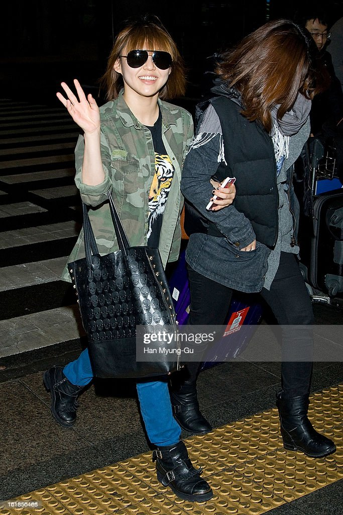 Min (L) of girl group Miss A is seen at Incheon International Airport on February 17, 2013 in Incheon, South Korea.