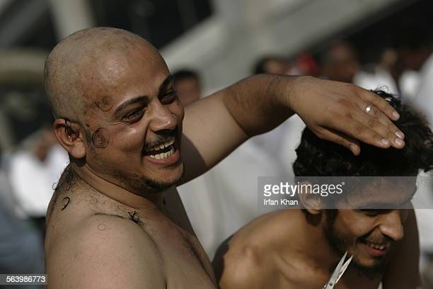 Mina December 19 2007 – – After his head shaven Ramadan Al Mutwali Al Zuheri shares a light moment while clipping hair of his friend Emad Ali as a...