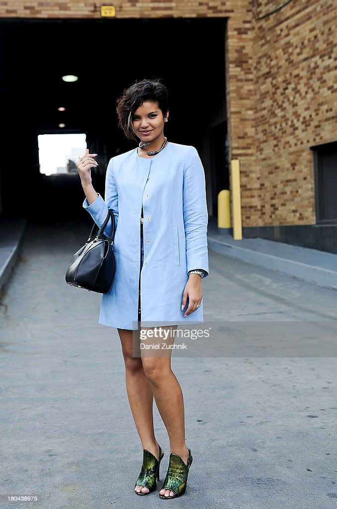 Mina K. Robertson is seen outside the Ralph Lauren show wearing a Zara coat, Zara bag with Jamaican bought accessories on September 12, 2013 in New York City.