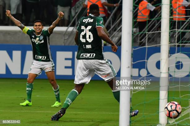 Mina of Brazil's Palmeiras celebrates with teammate Dudu his goal against Bolivia's Jorge Wilstermann during their Libertadores Cup football match...