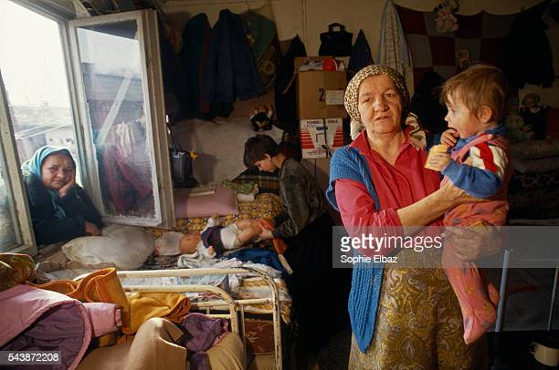 Mina Talic lives in this room with 12 other people from the Prijedor region Mina her mother and son go about their daily business in the Trnopolse...