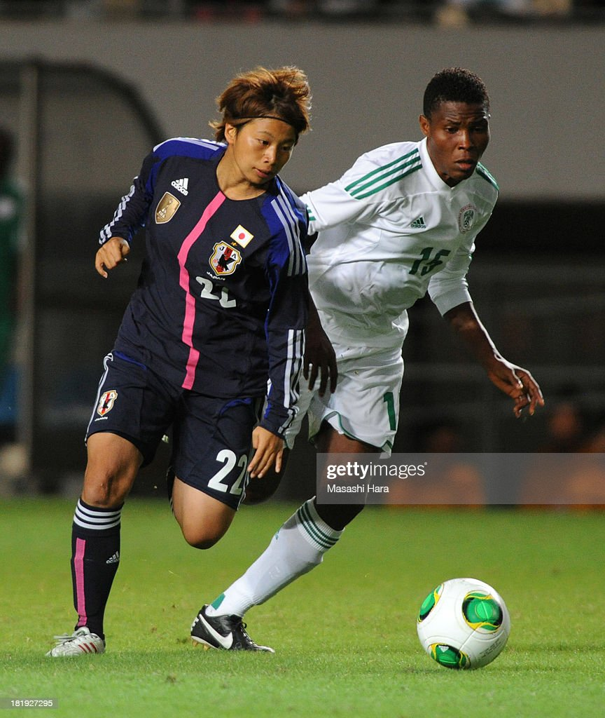 Mina Tanaka #22 of Japan and Osinachi Ohale #15 of Nigeria compete for the ball during the Women's international friendly match between Japan and Nigeria at Fukuda Denshi Arena on September 26, 2013 in Chiba, Japan.