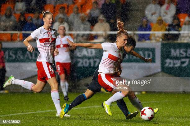 Mina Tanaka of Japan and Rachel Rinast of Switzerland compete for the ball during the international friendly match between Japan and Switzerland at...