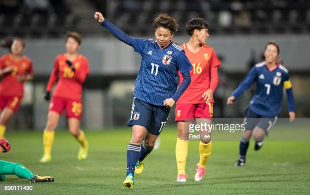 Mina Tanaka of Japan celebrates scoring the opening goal during the EAFF E1 Women's Football Championship between Japan and China at Fukuda Denshi...