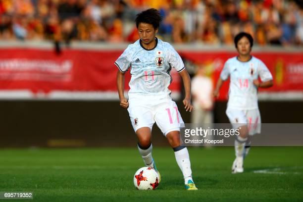 Mina Tanaka of Japan runs with the ball during the Women's International Friendly match between Belgium and Japan at Stadium Den Dreef on June 13...