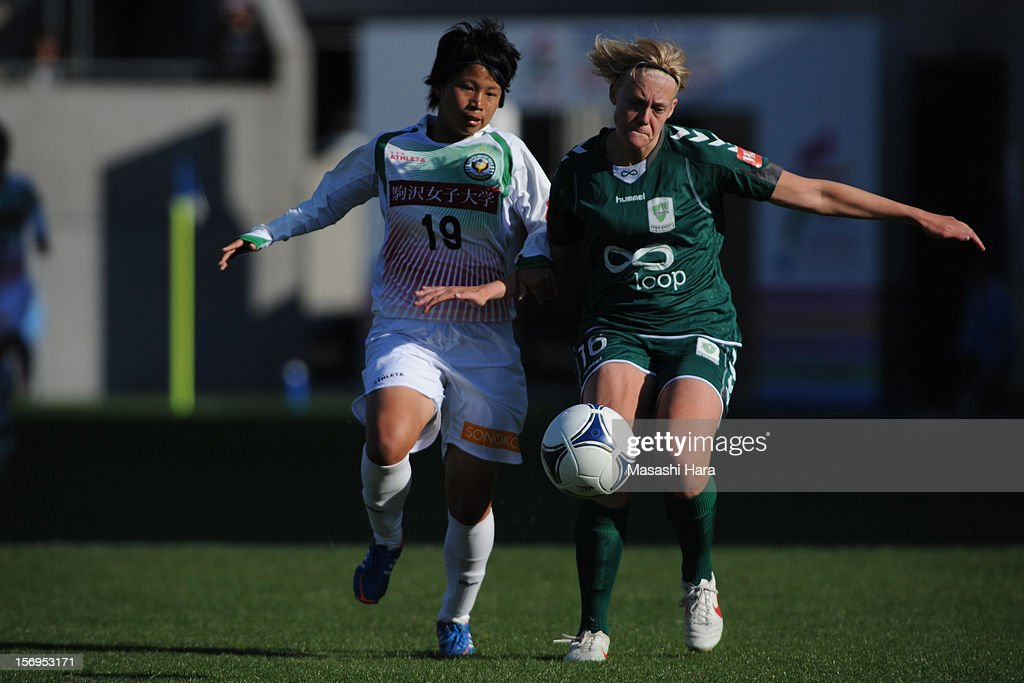 Mina Tanaka #19 of NTV Beleza (L) and Catherine Brown #16 of Canbarra United compete for the ball during the International Women's Club Championship 3rd Place Match between NTV Beleza and Canberra United at Nack5 Stadium Omiya on November 25, 2012 in Saitama, Japan.
