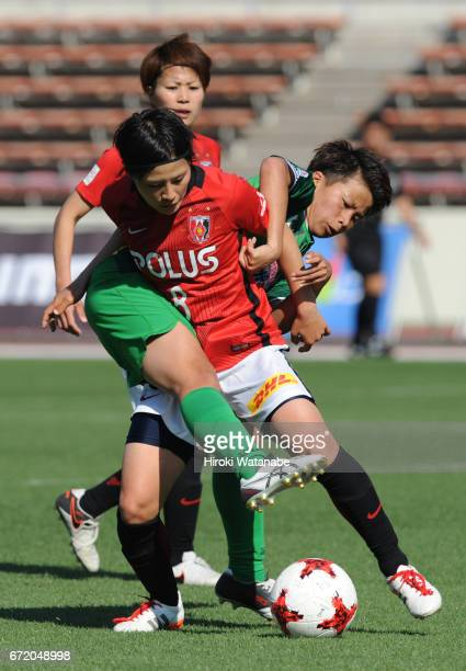Mina Tanaka of NTV Beleza and Hikaru Naomoto of Urawa Red Diamonds Ladies compete for the ball during the Nadeshiko League match between Ladies Urawa...