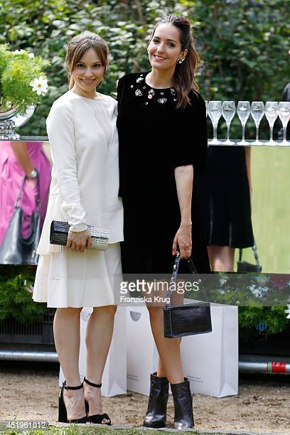 Mina Tander and Johanna Klum attend the Schumacher show during the MercedesBenz Fashion Week Spring/Summer 2015 at Sankt Elisabeth Kirche on July 10...