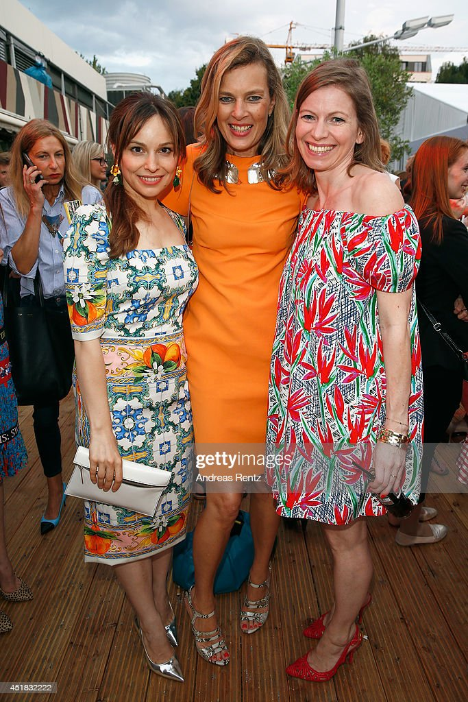 Mina Tander, Astrid Sass and guest attend the Opening Night by Grazia fashion show during the Mercedes-Benz Fashion Week Spring/Summer 2015 at Erika Hess Eisstadion on July 7, 2014 in Berlin, Germany.
