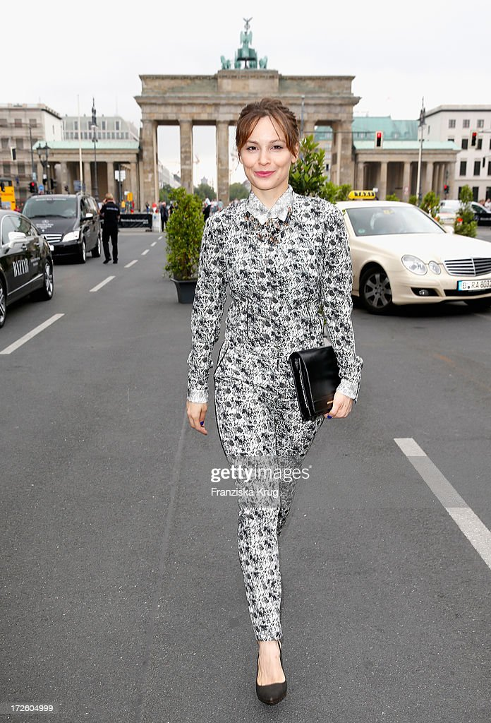 Mina Tander attends the Schumacher Show during Mercedes-Benz Fashion Week Spring/Summer 2014 at the Brandenburg Gate on July 4, 2013 in Berlin, Germany.