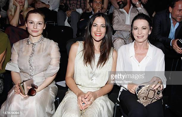 Mina Tander Bettina Zimmermann and Iris Berben arrive for the Dawid Tomaszewski Show during the MercedesBenz Fashion Week Spring/Summer 2013 on July...
