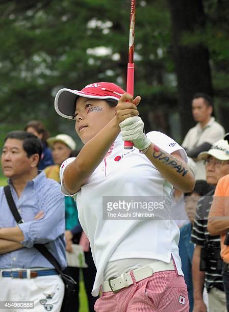 Minami Katsu of Japan hits a shot during the final round of the 26th Espirito Santo Trophy Women's World Amateur Team Championship at Karuizawa 72...