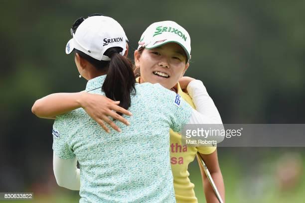 Minami Katsu of Japan hugs Sakura Yokomine of Japan on the 18th green during the second round of the NEC Karuizawa 72 Golf Tournament 2017 at the...
