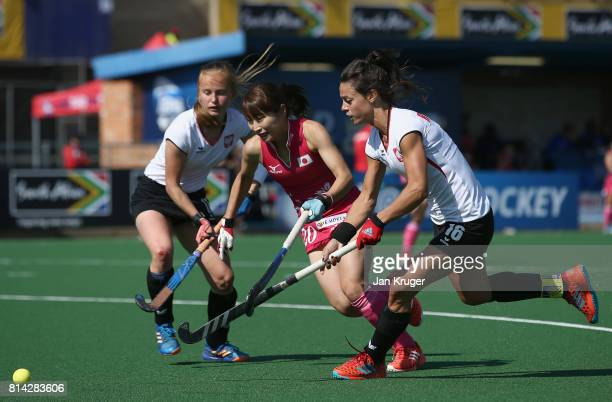 Minami Shimizu of Japan and Marlena Rybacha of Poland battle for possession during day 4 of the FIH Hockey World League Semi Finals Pool B match...