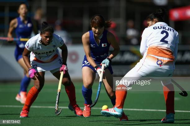Minami Shimizu of Japan attempts to keep possesion from Deep Ekka of India and Gurjit Kaur of India during the 5th8th Place playoff match between...