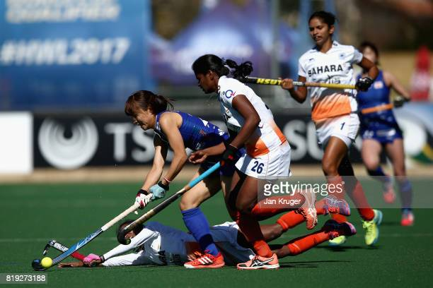 Minami Shimizu of Japan attempts to keep possesion while under pressure from Nikki Pradhan of India and Sunita Lakra of India during the 5th8th Place...