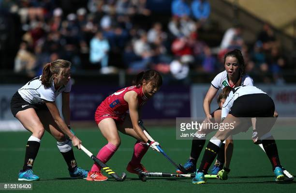 Minami Shimizu of Japan is blocked by Franziska Hauke Cecile Pieper and Charlotte Stapenhorst of Germany during day 5 of the FIH Hockey World League...